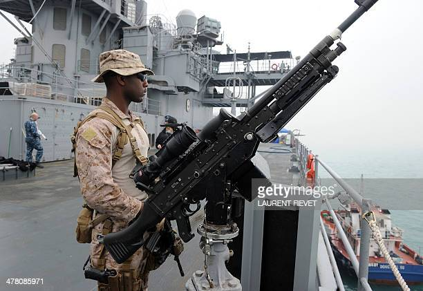 A Fleet Antiterrorism Security Teams officer stands guard on the USS Blue Ridge during a media tour in Hong Kong on March 12 2014 The USS Blue Ridge...