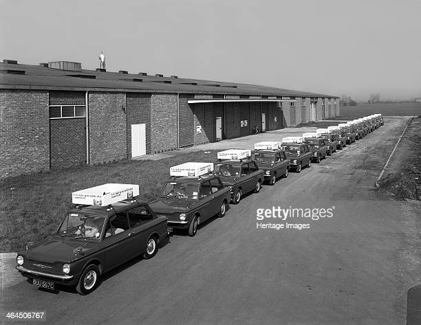 A fleet of 1965 Hillman Imps Selby North Yorkshire 1965 In a bid to promote the consumption of canned fruit the Shepperton Preserve company of...