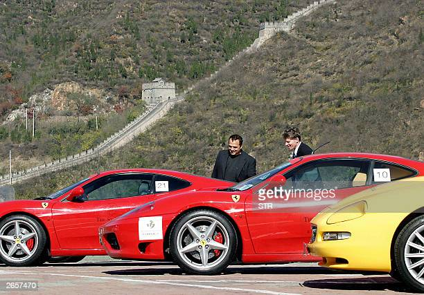 A fleet of Ferraris sports cars line up with the background of the Great Wall of China at Juyongguan in the suburbs of Beijing 27 October 2003...