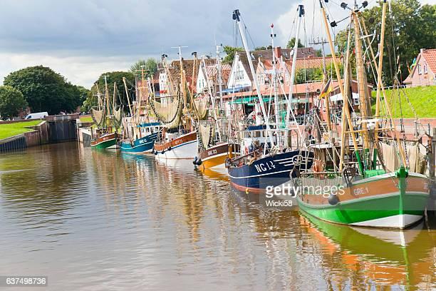 Fleet of fishing boats and shrimp boats at the harbor of Greetsiel