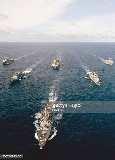 fleet of military ships at sea in atlantic ocean - military convoy stock photos and pictures