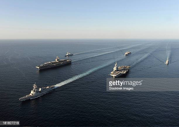 fleet of navy ships transit the arabian sea. - convoy stock pictures, royalty-free photos & images