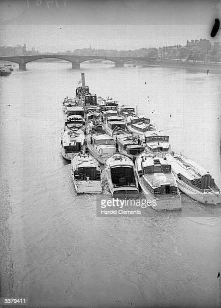 A fleet of small motor boats being towed up the Thames after taking part in the BEF Dunkirk rescue