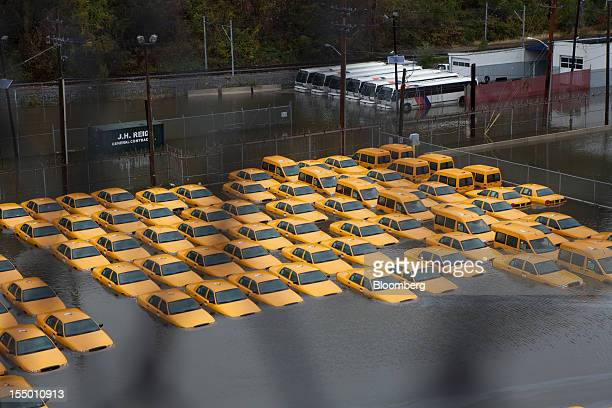A fleet of taxis sits submerged in water in Hoboken New Jersey US on Tuesday Oct 30 2012 The Atlantic storm Sandy left a landscape of devastation...