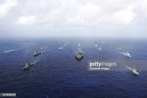 A fleet of U.S. Navy and Japan Maritime Self-Defense Force ships transit the Pacific Ocean.