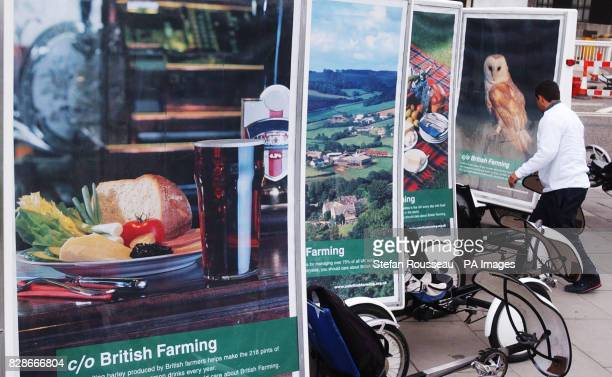 A fleet of vehicles decked out with images of the British landscape and British food gathered in London the cyclists pulling the billboards from the...