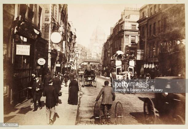 Fleet Street and Ludgate Circus with a tricycle in the foreground a horsedrawn bus on the right and St Paul�s Cathedral in the distance Photograph...
