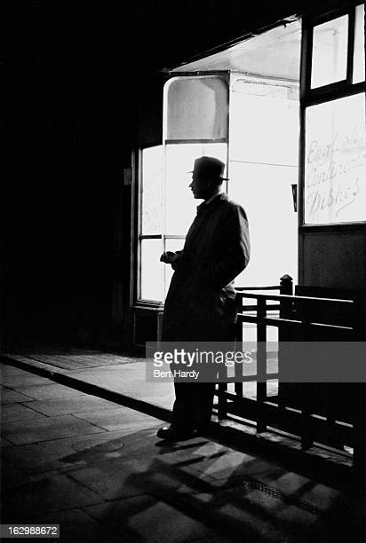 Fleet Street crime reporter 'Jeep' Whitall of the Daily Mirror waiting for a contact outside a cafe London May 1947 Original publication Picture Post...