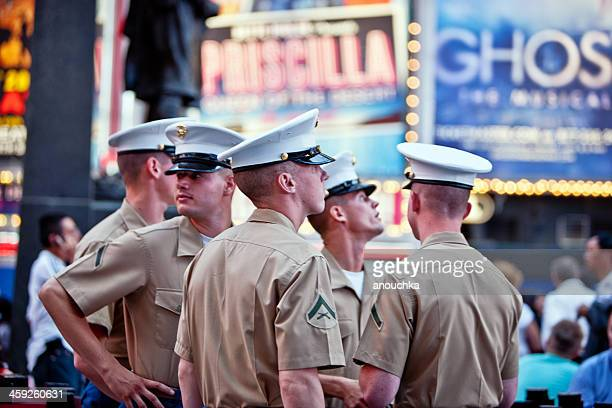 fleet week in new york, us marines on times square - fleet week stock photos and pictures