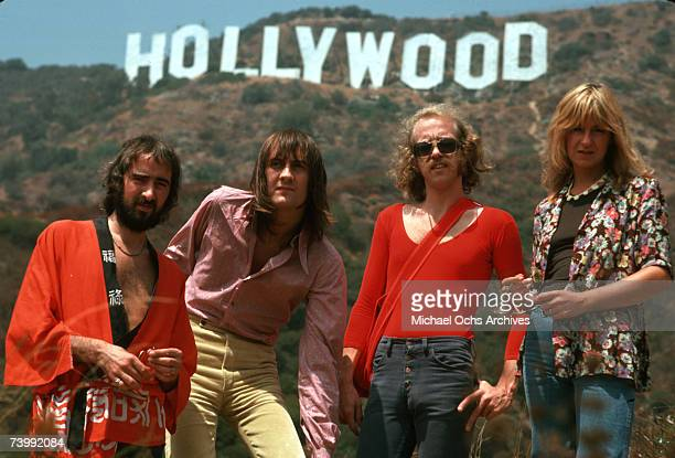 Fleetwood Mac pose for a portrait under the Hollywood Sign AUGUST 1974 in Los Angeles California