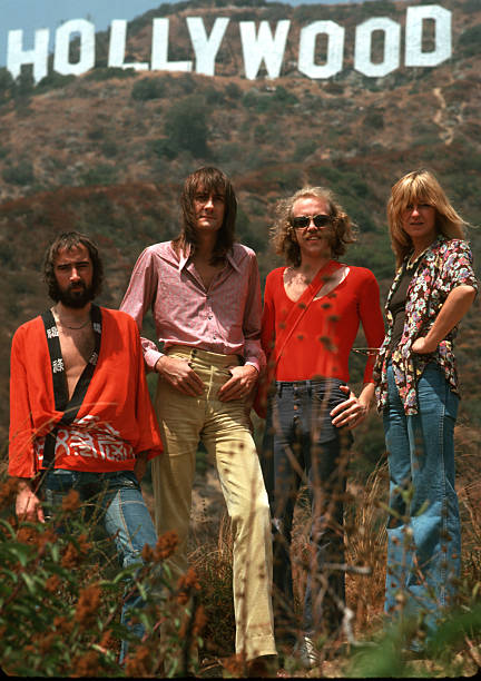 LOS ANGELES - CIRCA 1975:  Fleetwood Mac (L-R: John McVie, Mick Fleetwood, Bob Welch and Christine McVie) pose for a portrait under the Hollywood Sign circa 1975 in Los Angeles, California.  (Photo by Michael Ochs Archives/Getty Images)Fleetwood Mac