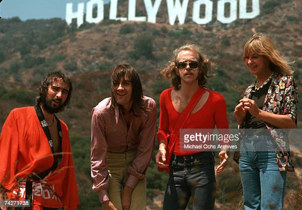 Fleetwood Mac pose for a portrait under the Hollywood Sign AUGUST 1974 in Los Angeles, California.