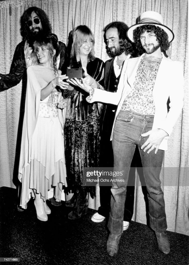 Fleetwood Mac (L-R Mick Fleetwood, Stevie Nicks, Christine McVie, John McVie and Lindsey Buckingham) pose for photographers backstage at the 5th American music Awards held at the Santa Monica Civic Auditorium on January 16, 1978 in Santa Monica, California.