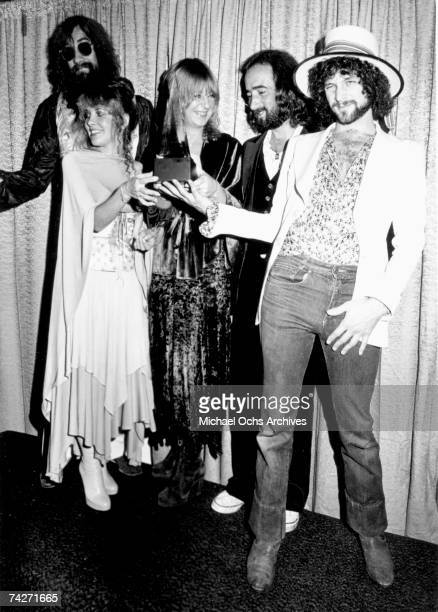 Fleetwood Mac pose for photographers backstage at the 5th American music Awards held at the Santa Monica Civic Auditorium on January 16, 1978 in...