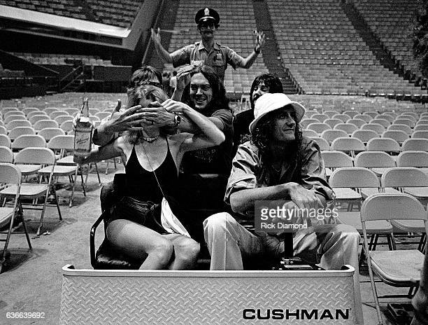 Fleetwood Mac Rock and Roll Hall of Fame Mick Fleetwood carts around with friends at The Omni Coliseum in Atlanta Georgia June 1 1977