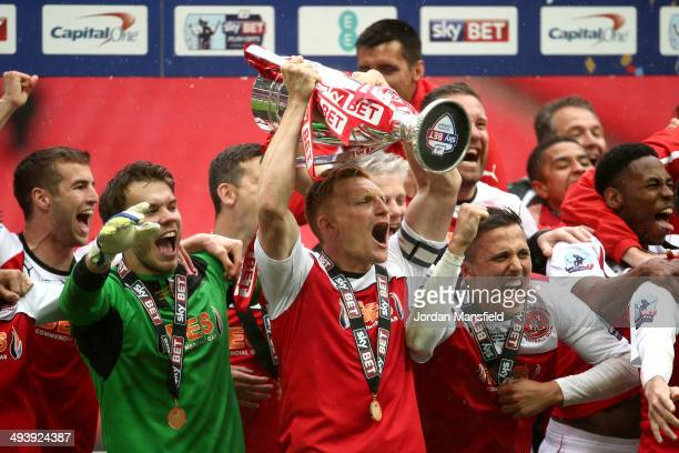 Fleetwood players celebrate promotion from Division 2 after the Sky Bet League Two Playoff Final between Burton Albion and Fleetwood Town at Wembley...