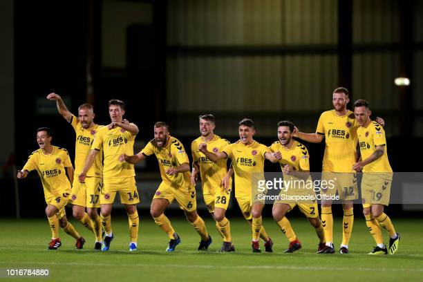 Fleetwood players celebrate victory at the end of the penalty shootout after the Carabao Cup First Round match between Crewe Alexandra and Fleetwood...