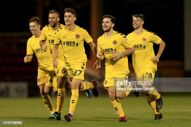 Harrison Biggins of Fleetwood leads the celebrations as his side emerge victorious in the penalty shootout during the Carabao Cup First Round match...