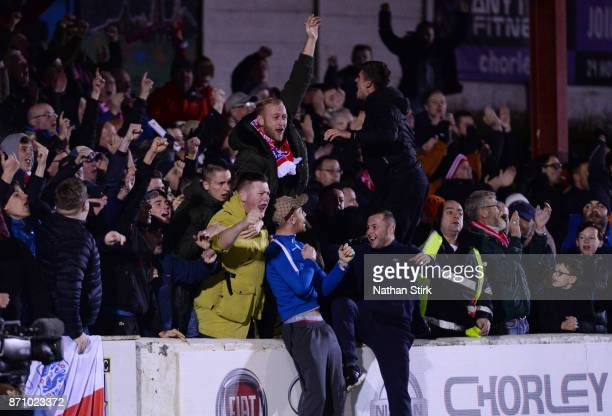 Fleetwood Town fans celebrate during The Emirates FA Cup First Round match between Chorley and Fleetwood Town at Victory Park on November 6 2017 in...