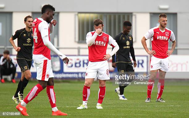 Fleetwood Town players look dejected ahead of the restart as Milton Keynes Dons' Ryan Colclough scored his sides fourth goal from the penalty spot...