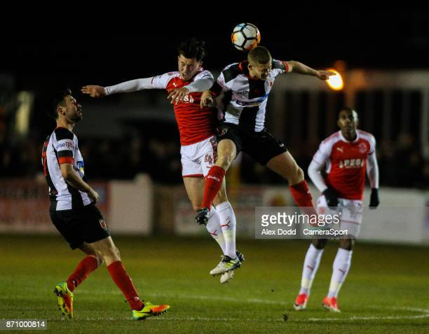 Fleetwood Town's Aiden O'Neill battles with Chorley's Matt Challoner during the FA Cup First Round match between Chorley v Fleetwood at Victory Park...