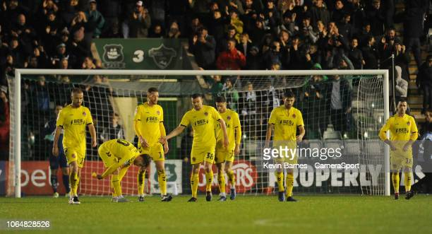 Fleetwood Town's Alex Cairns Paddy Madden Conor McAleny Cian Bolger James Wallace Wes Burns Ched Evans and Ryan Taylor look dejected after Plymouth...