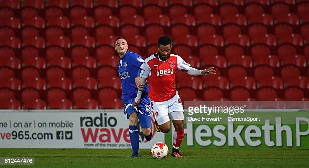 Fleetwood Town's Alex Jakubiak battles his way through during the EFL Checkatrade Trophy match between Fleetwood Town and Oldham Athleticl at...