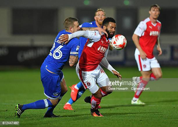 Fleetwood Town's Alex Jakubiak battles with Oldham Athletic's Peter Clarke during the EFL Checkatrade Trophy match between Fleetwood Town and Oldham...