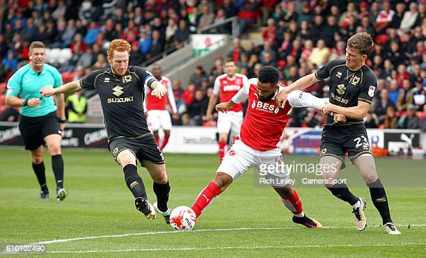 Fleetwood Town's Alex Jakubiak holds off the challenge from Milton Keynes Dons' Paul Downing during the Sky Bet League One match between Fleetwood...