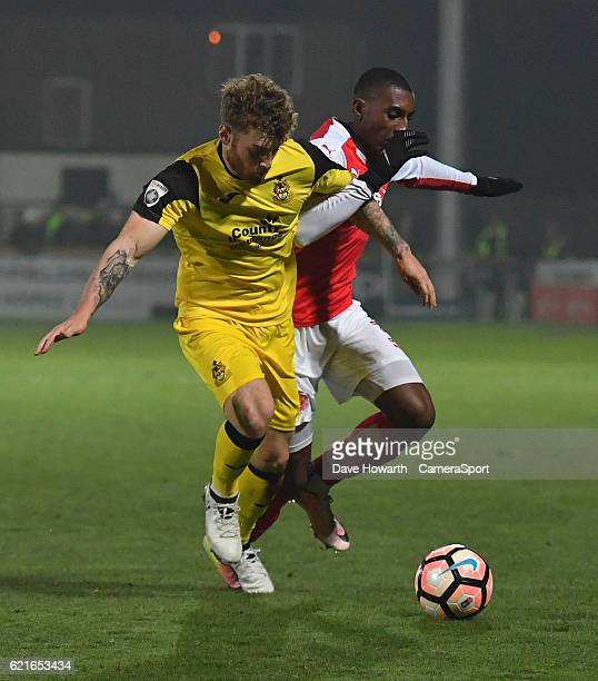 Fleetwood Town's Amari'i Bell battles with Southport's Ryan Higgins during the The Emirates FA Cup First Round match between Southport and Fleetwood...