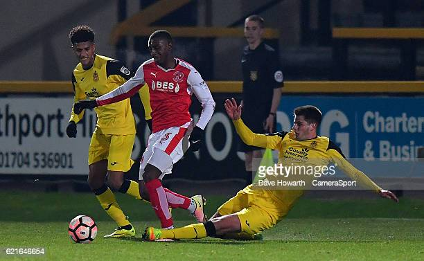Fleetwood Town's Amari'i Bell is tackled during the The Emirates FA Cup First Round match between Southport and Fleetwood Town at the Merseyrail...