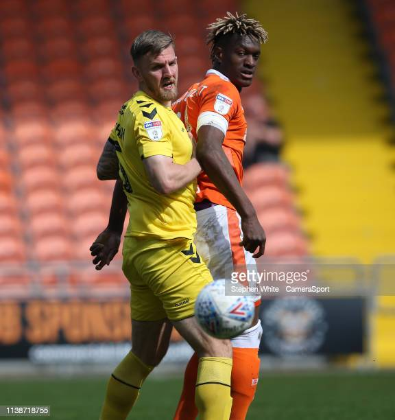 Fleetwood Town's Ashley Eastham and Blackpool's Armand Gnanduillet during the Sky Bet League One match between Blackpool and Fleetwood Town at...