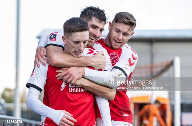 Fleetwood Town's Ashley Hunter celebrates scoring his side's second goal with team mates Ched Evans and Wes Burns during the FA Cup First Round match...