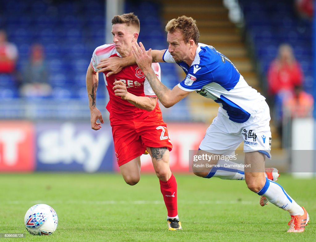 Fleetwood Town's Ashley Hunter is fouled by Bristol Rovers' Chris Lines during the Sky Bet League One match between Bristol Rovers and Fleetwood Town at Memorial Stadium on August 26, 2017 in Bristol, England.