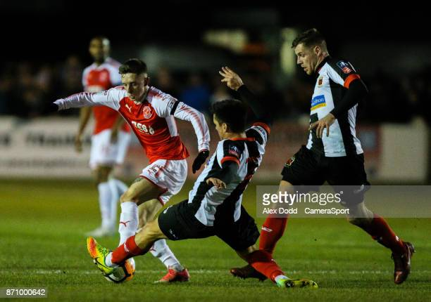 Fleetwood Town's Ashley Hunter is tackled by Chorley's Stephen Jordan during the FA Cup First Round match between Chorley v Fleetwood at Victory Park...