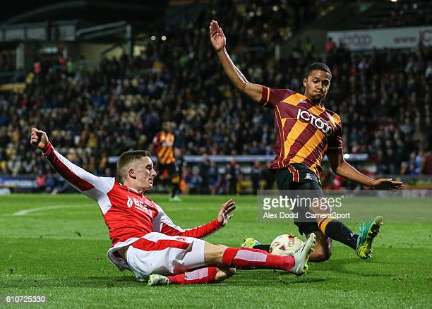 Fleetwood Town's Ashley Hunter tries to get a cross past Bradford City's Timothee Dieng during the Sky Bet League One match between Bradford City and...