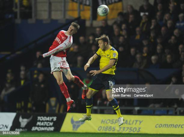 Fleetwood Town's Ashley Hunter vies for possession with Oxford United's Todd Kane during the Sky Bet League One match between Oxford United and...