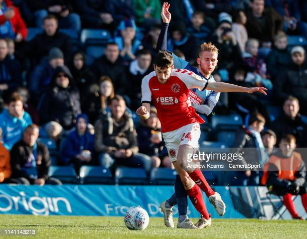 Fleetwood Town's Ashley Nadesan competing with Wycombe Wanderers' Jason McCarthy during the Sky Bet League One match between Wycombe Wanderers and...