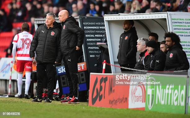 Fleetwood Town's assistant head coach Rob Kelly left and Fleetwood Town manager Uwe Rosler during the Sky Bet League One match between Doncaster...