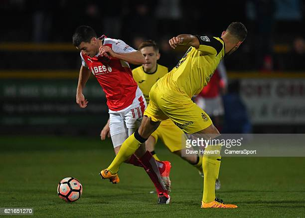 Fleetwood Town's Bobby Grant battles with Southport's Josh Thompson during the The Emirates FA Cup First Round match between Southport and Fleetwood...