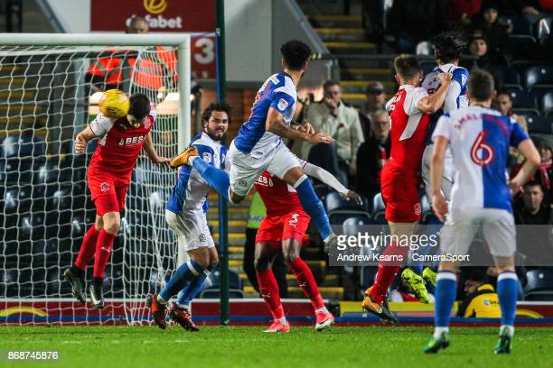 Fleetwood Town's Bobby Grant heads clear a header from Blackburn Rovers' Derrick Williams during the Sky Bet League One match between Blackburn...