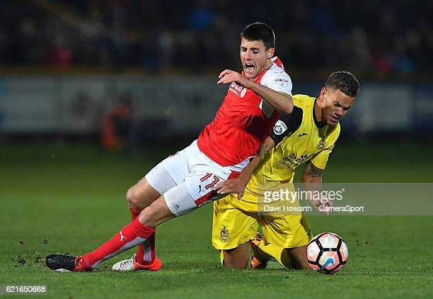 Fleetwood Town's Bobby Grant is fouled by Southport's Josh Thompson during the The Emirates FA Cup First Round match between Southport and Fleetwood...