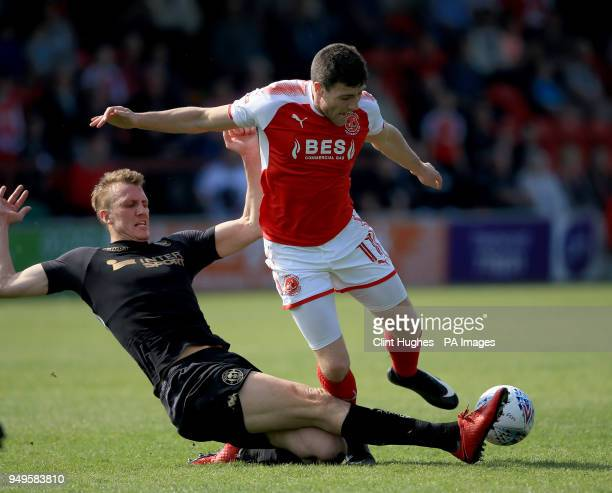 Fleetwood Town's Bobby Grant is tackled by Wigan Athletic's Dan Burn during the Sky Bet League One match at Highbury Stadium Fleetwood