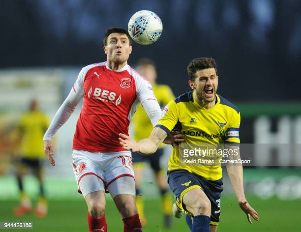 Fleetwood Town's Bobby Grant vies for possession with Oxford United's John Mousinho during the Sky Bet League One match between Oxford United and...