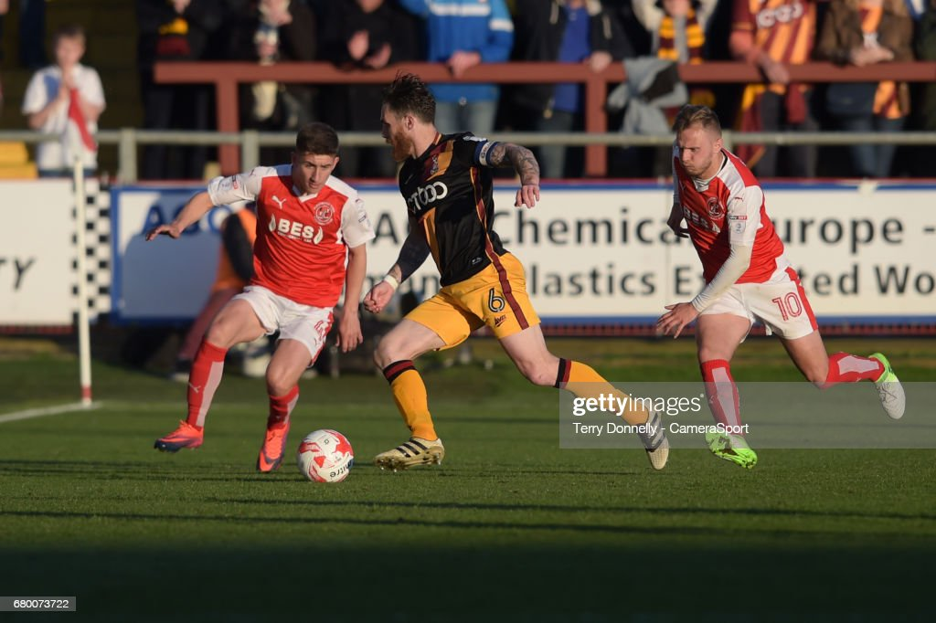 Fleetwood Town's Cameron Brannagan battles with Bradford City's Romain Vincelot during the Sky Bet League One Play-Off Semi-Final Second Leg match between Fleetwood Town and Bradford City at Highbury Stadium on May 7, 2017 in Fleetwood, England.