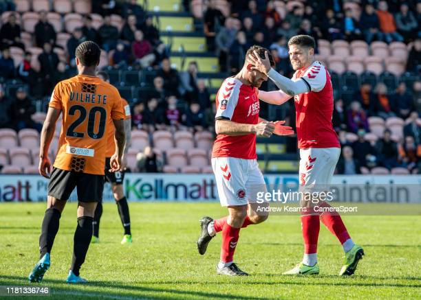 Fleetwood Town's Ched Evans celebrates scoring his side's first goal with team mate Danny Andrew during the FA Cup First Round match between Barnet...