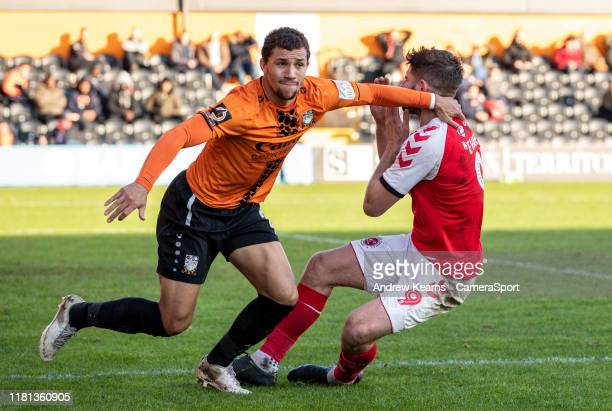 Fleetwood Town's Ched Evans competing with Barnet's Elliot Johnson during the FA Cup First Round match between Barnet and Fleetwood Town at The Hive...