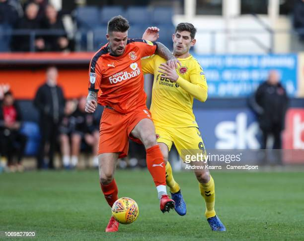 Fleetwood Town's Ched Evans competing with Luton Town's Sonny Bradley during the Sky Bet League One match between Luton Town and Fleetwood Town at...