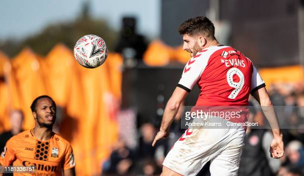 Fleetwood Town's Ched Evans heads during the FA Cup First Round match between Barnet and Fleetwood Town at The Hive on November 10, 2019 in Barnet,...