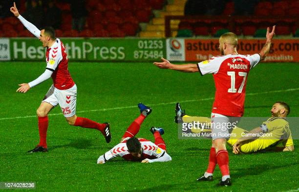 Fleetwood Town's Ched Evans is fouled in the penalty box by Burton Albion's Jake Buxton during the Sky Bet League One match between Fleetwood Town...